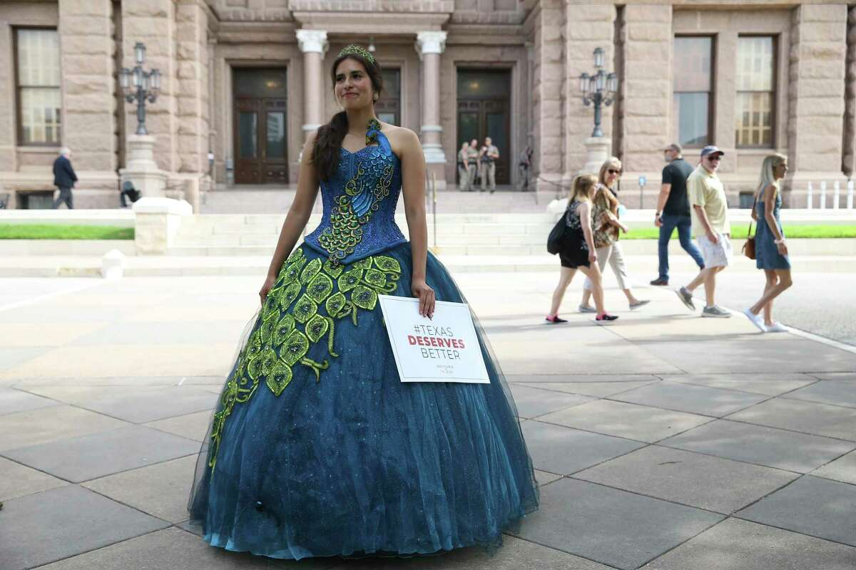 Dressed in her Quincenera gown, Wendy Rodriguez, 22, arrives early for a vote rally at the State Capitol, Tuesday, July 13, 2021. Speakers from several organizations are scheduled to speak during the rally