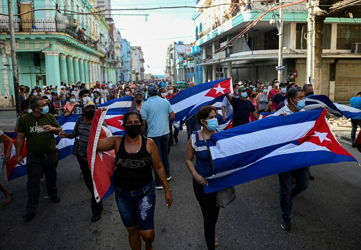 People take part in a demonstration to support the government of the Cuban President Miguel Diaz-Canel in Havana, on Sunday, July 11, 2021.