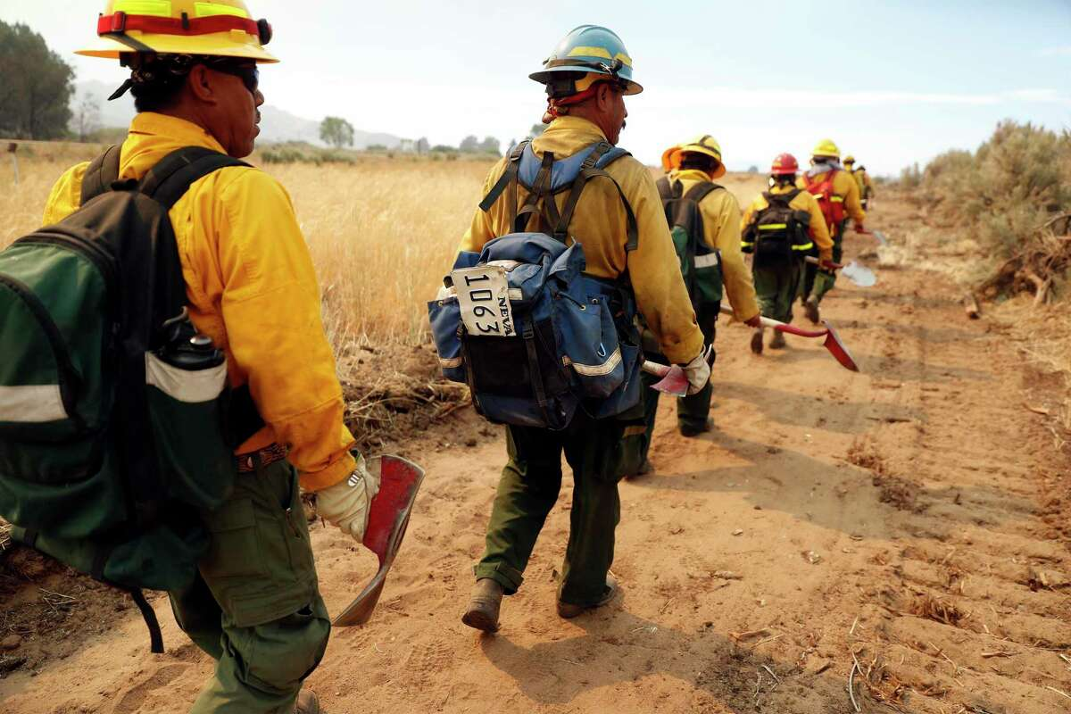 Lava River Forestry woodland firefighters head in to help fight the Beckwourth Complex fire in Lassen County on Monday.
