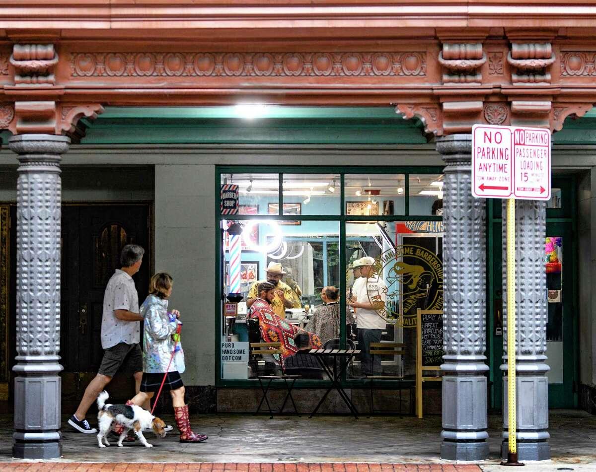 Tommie Gonzalez's Puro Handsome Barbershop next to the Majestic Theatre.