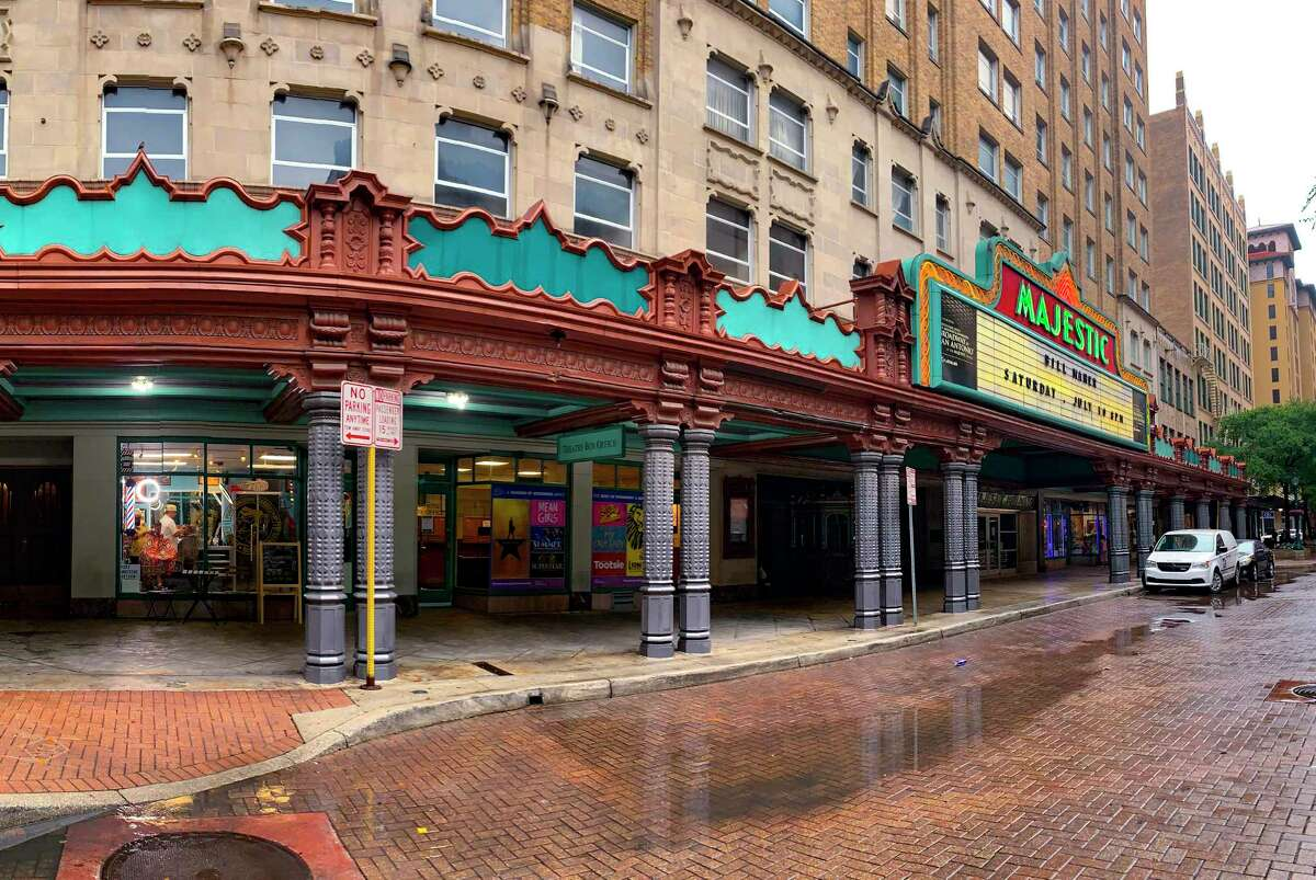 Puro Handsome barbershop, visible at left, is located by the iconic Majestic Theatre in downtown San Antonio.