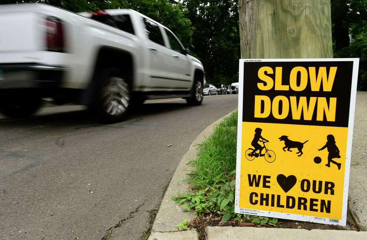 Yard signs asking drivers to slow down on Prospect Avenue between Grandview and the hospital Tuesday, July 13, 2021, in Norwalk, Conn.
