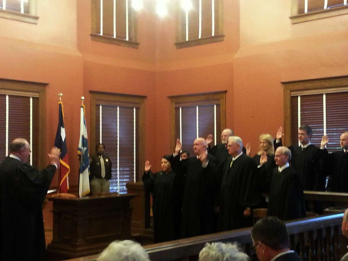 File photo from Jan. 1, 2017 shows District Court and County Court judges sworn in for their new terms in office by 434th District Court Judge James Shoemake at the Fort Bend County Courthouse.
