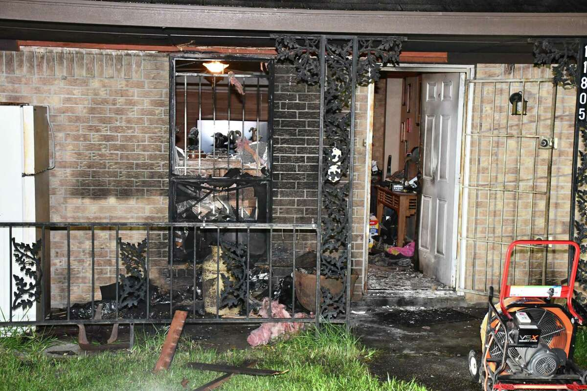 The front of a Conroe house is seen following a fire, which investigators say was started by a man Monday night.