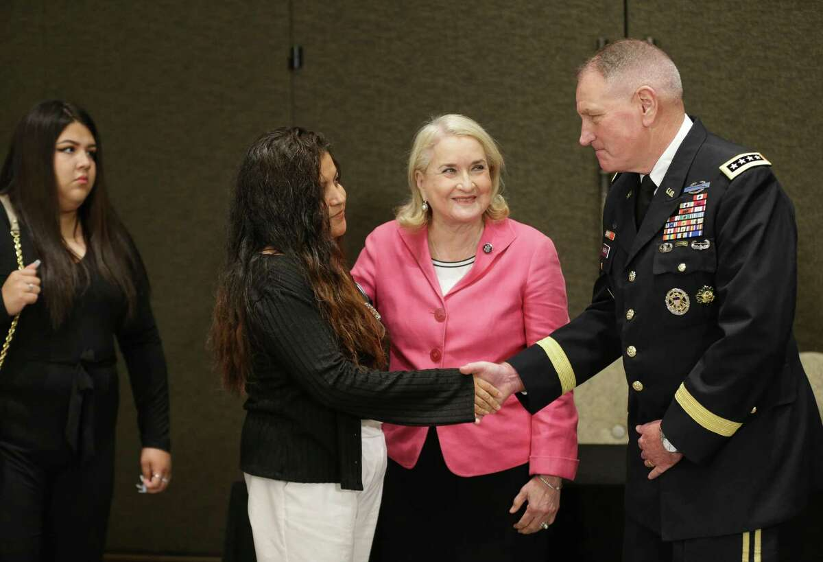 Gloria Guillén shakes hands with U.S. Army General John M. Murray before discussing the latest report on the death investigation of her daughter, Houston soldier Vanessa Guillén, on Tuesday, July 13, 2021, in Houston. Guillén was an Army specialist who was slain while on active duty at Fort Hood in April 2020. Democratic Congresswoman Sylvia Garcia, between them, represents the Guillén's district in Congress and attended the meeting.