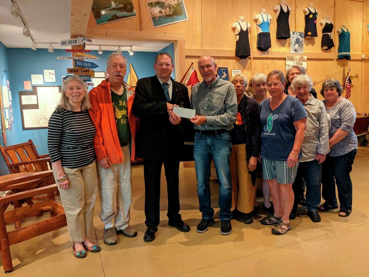 Sheriff Rich Martin presented the LCHS board with donation check of $1,000 from the Sheriff's Department Charitable Campaign. (Photo courtesy of Sheriff Martin)