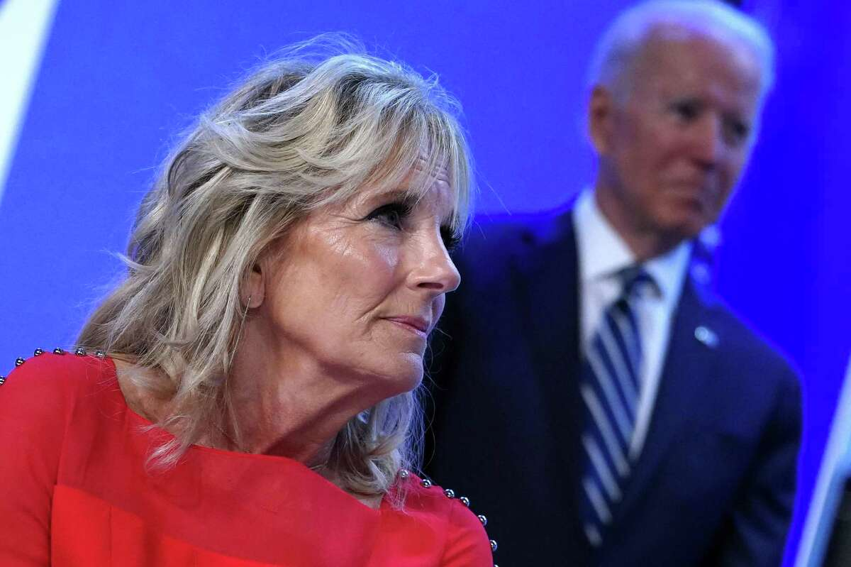 """(FILES) In this file photo US President Joe Biden and First Lady Jill Biden attend the National Education Association's Annual Meeting and Representative Assembly in the Walter E. Washington Convention Center in Washington, DC on July 2, 2021. - The White House on July 13, 2021 said First Lady Jill Biden will lead the US delegation to the Tokyo Olympics, which President Joe Biden is skipping due to Japan's Covid lockdown. """"First Lady Jill Biden will travel to the Opening Ceremony of the 2021 Olympic Summer Games,"""" the White House said. The ceremony takes place July 23, 2021. (Photo by MANDEL NGAN / AFP) (Photo by MANDEL NGAN/AFP via Getty Images)"""