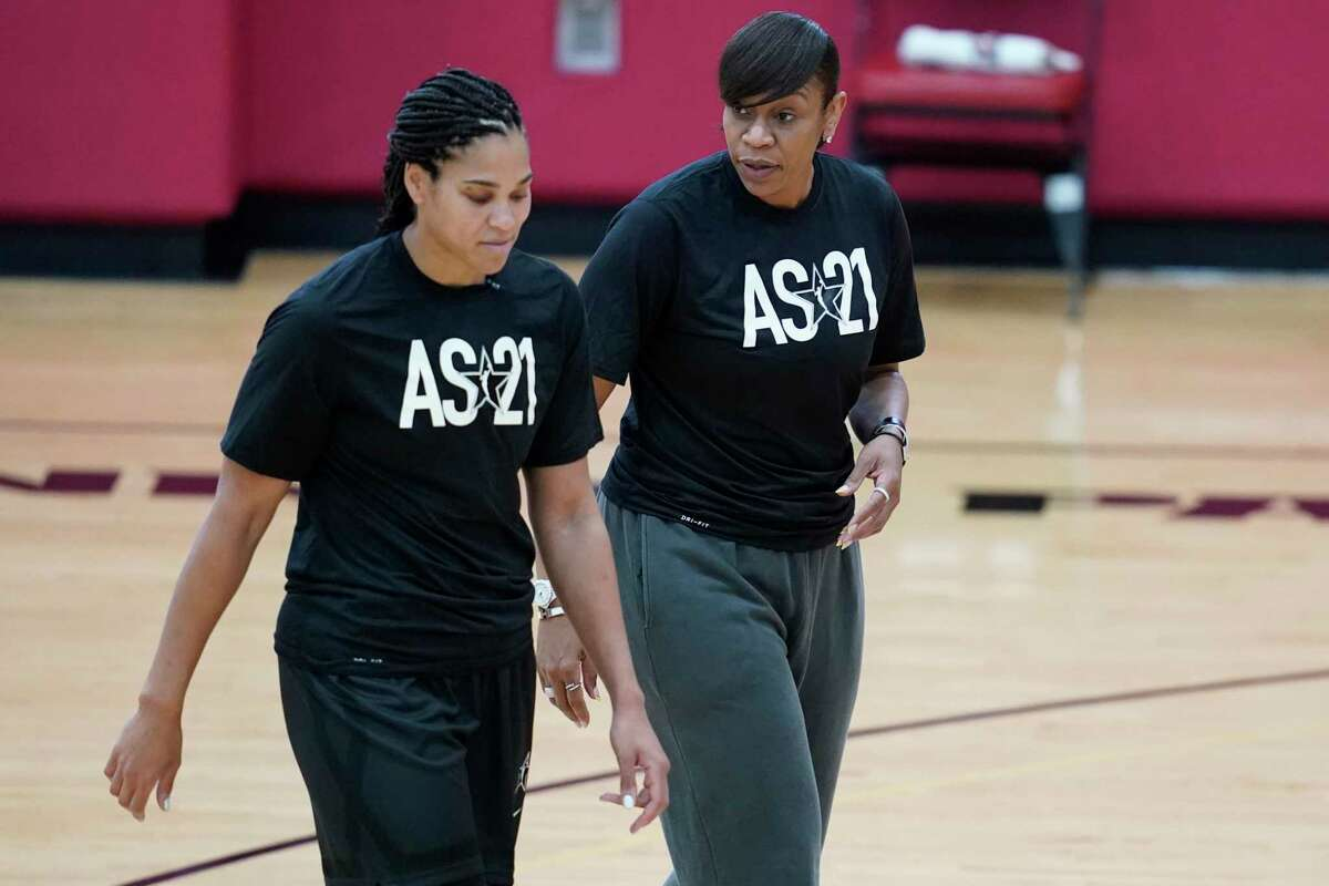 Coach Tina Thompson, right, speaks with Brionna Jones during practice for the WNBA All-Star Basketball team, Tuesday, July 13, 2021, in Las Vegas. (AP Photo/John Locher)