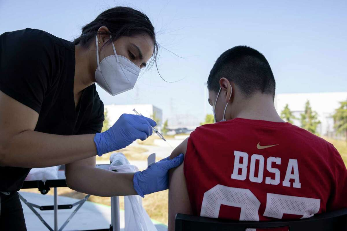 A nurse gives a vaccine shot at the East Palo Alto VAXX UP event.