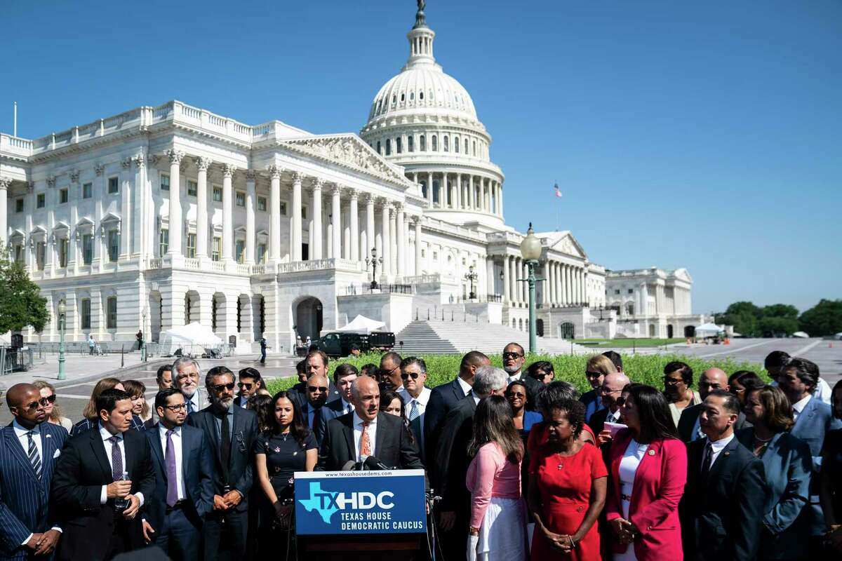 Rep. Chris Turner, chair of the Texas House Democratic Caucus, speaks alongside his Democratic colleagues during a news conference outside the U.S. Capitol on July 13, 2021.