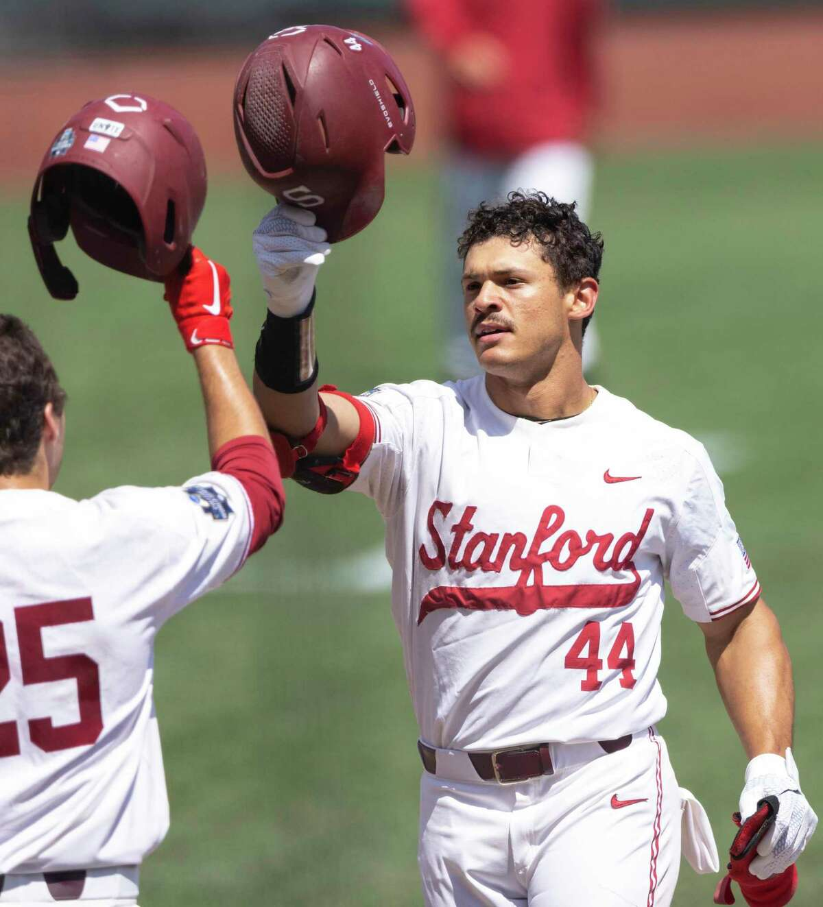 Stanford's Christian Robinson, right, celebrates with Kody Huff (25) after hitting a two-run home run against North Carolina State in the seventh inning in the opening baseball game of the College World Series Saturday, June 19, 2021, at TD Ameritrade Park in Omaha, Neb. (AP Photo/Rebecca S. Gratz)