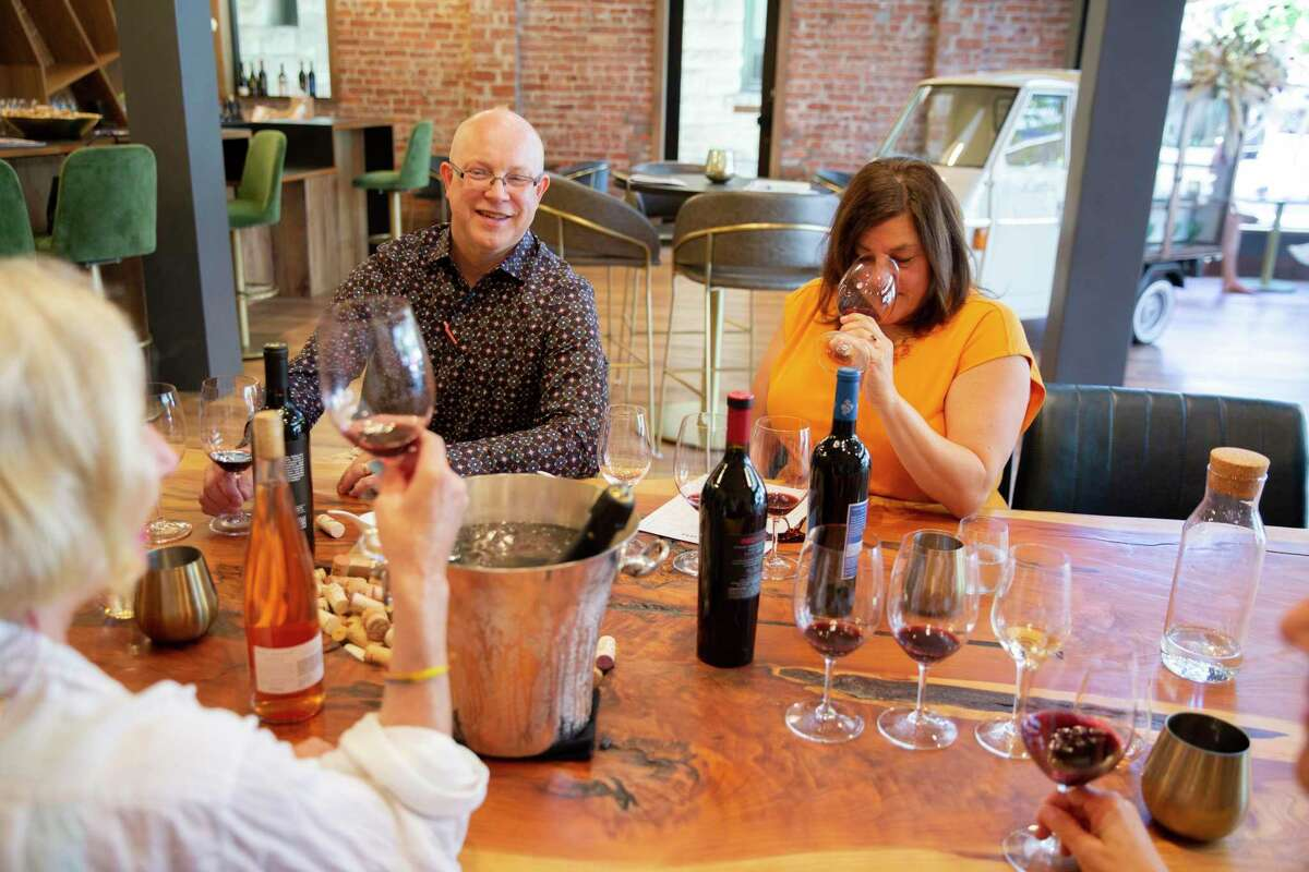 Mia Carta general manager Jim Foster, left, and Rebecca Sciandri Griffin of Sciandri Family Vineyards at their shared tasting room in Napa.