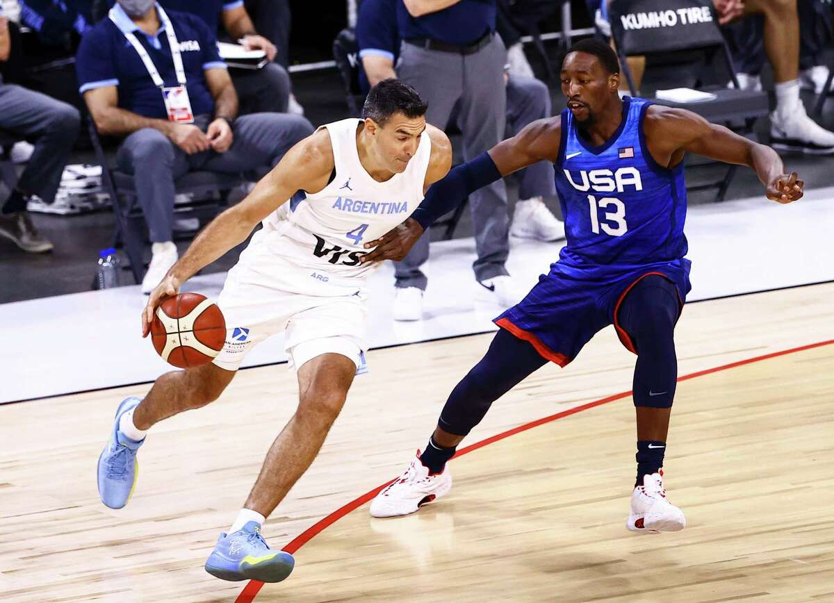 Argentina's Luis Scola (4) drives the ball against United States' Bam Adebayo (13) during the first half of an exhibition basketball game in Las Vegas.
