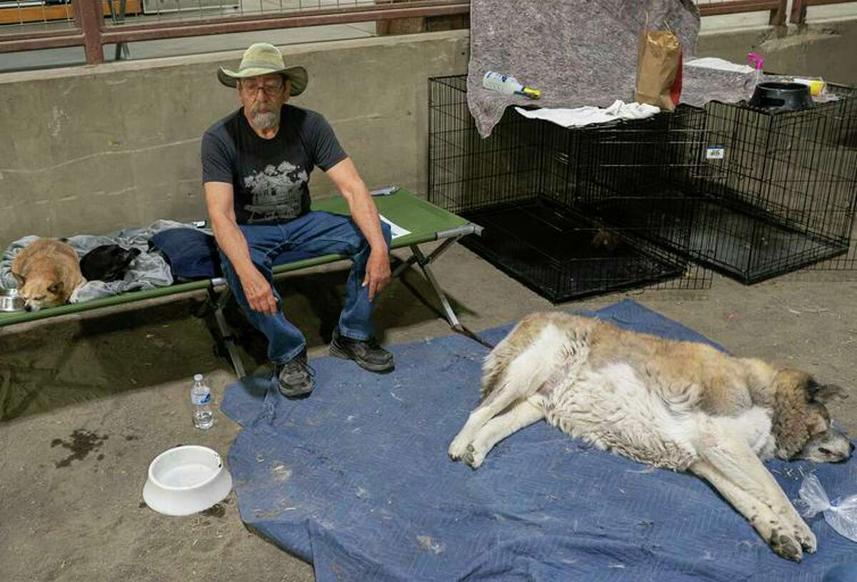 Art Garcia rests after evacuating to a Red Cross shelter near the Bootleg Fire in Klamath Falls, Ore.