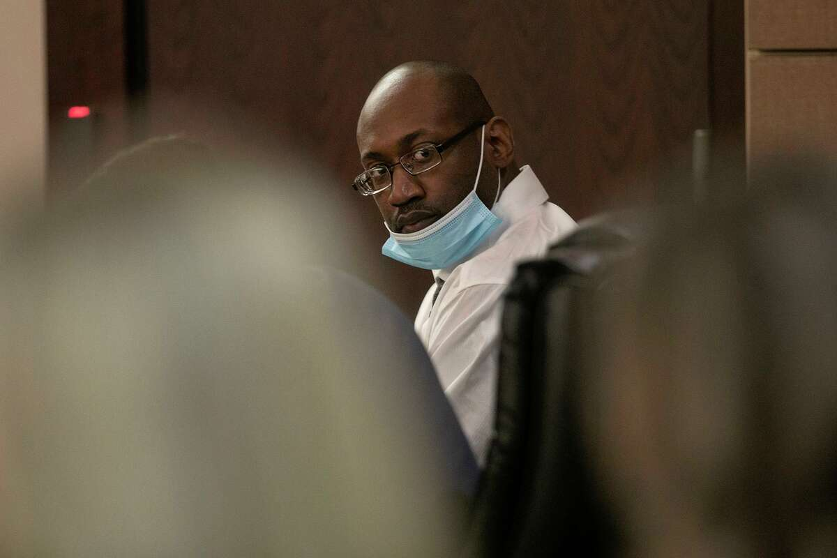Defendant Otis McKane looks around Tuesday during the second day of his capital murder trial in the killing of San Antonio Police Detective Benjamin Marconi in 2016.