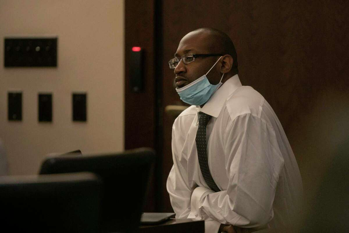 Defendant Otis McKane waits for court to resume during a break on the second day of his capital murder trial,