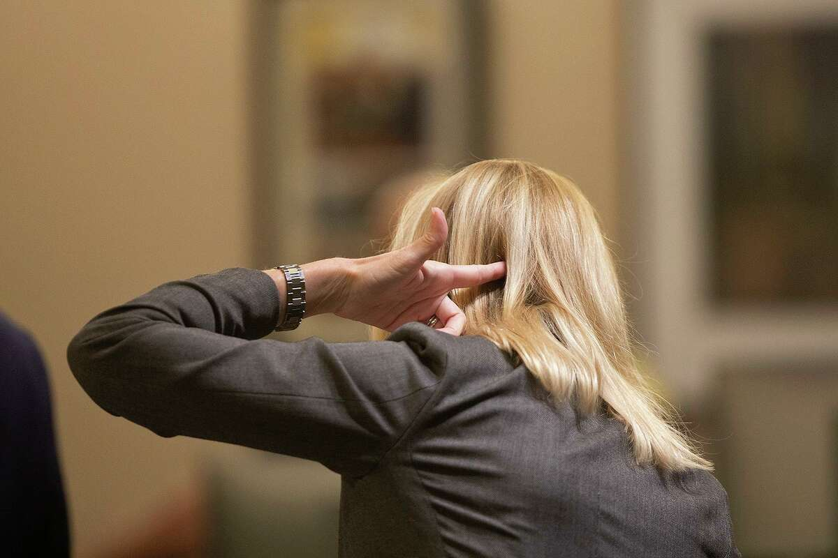 Prosecutor Tamara Strauch points her hand like a gun to show what a video from a second angle shows of the shooting of San Antonio Police Detective Benjamin Marconi in 2016.