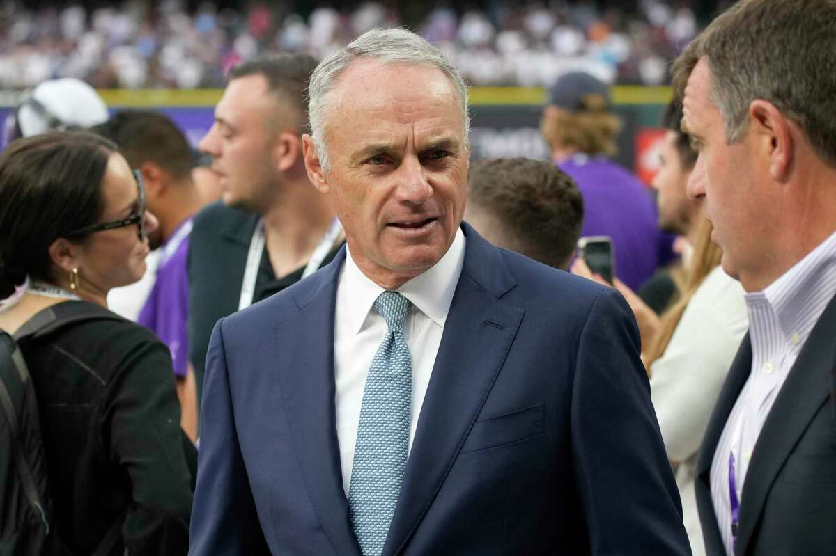 MLB Commisioner Rob Manfred watches batting practice prior to the MLB All-Star baseball game, Tuesday, July 13, 2021, in Denver. (AP Photo/David Zalubowski)
