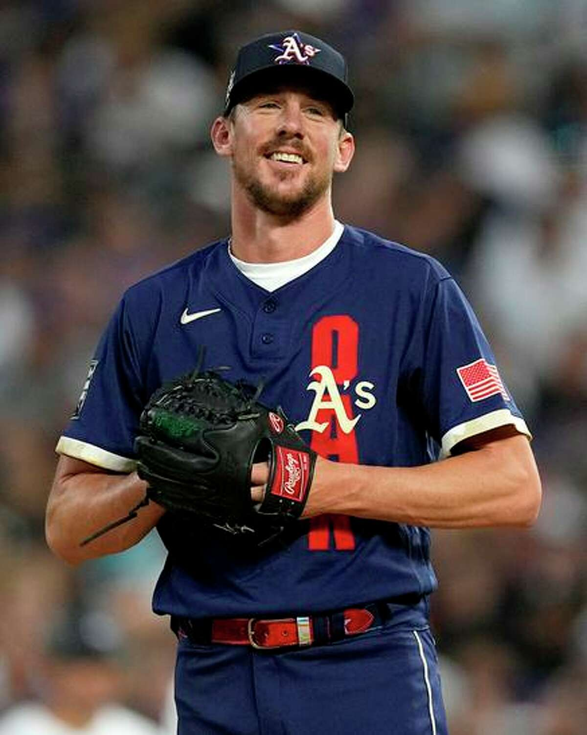 American League's Chris Bassitt of the Oakland Athletics smiles before his pitch during the sixth inning of the MLB All-Star baseball game, Tuesday, July 13, 2021, in Denver. (AP Photo/Jack Dempsey)
