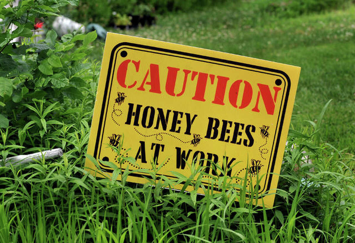 Sign in the front of beekeeper Tom Simpson's house, which is located on 14 acres of land.