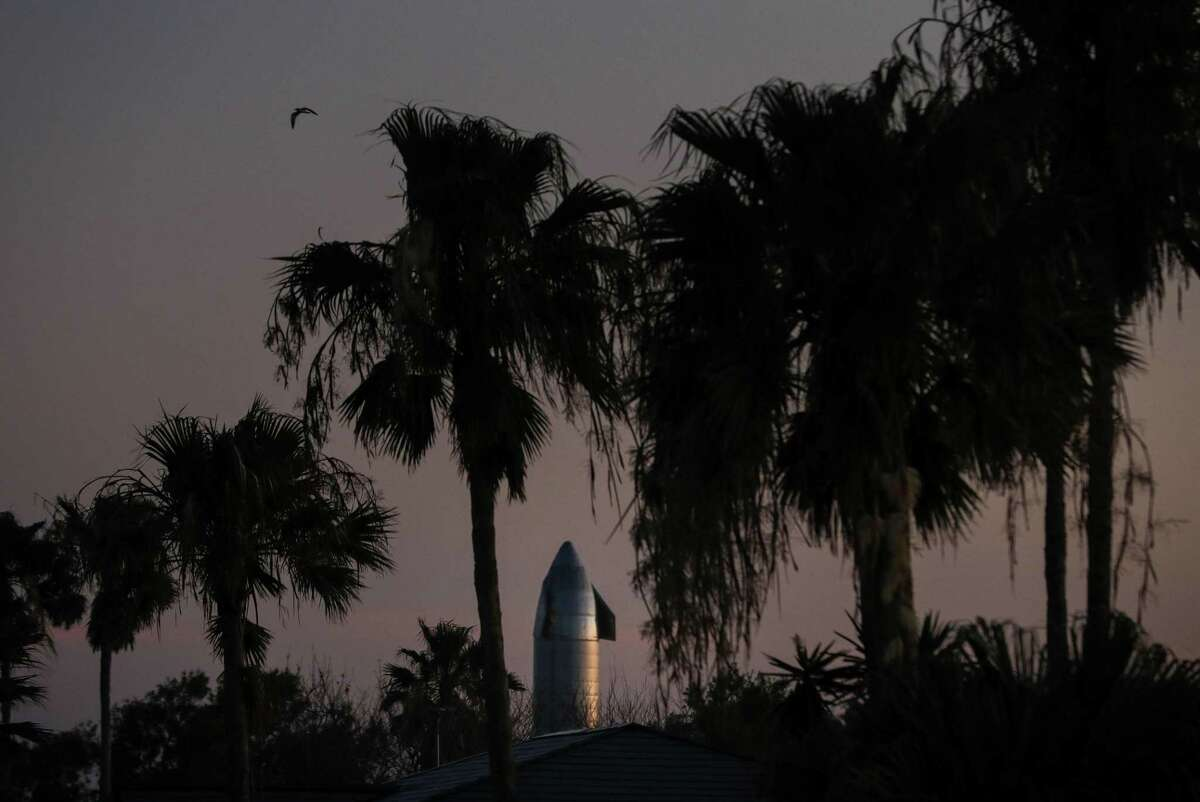 A SpaceX Starship prototype is illuminated by the setting sun Tuesday, June 15, 2021, in Boca Chica Village, an unincorporated area near Brownsville. The Starship spacecraft has been selected by NASA to lower astronauts to the moon.