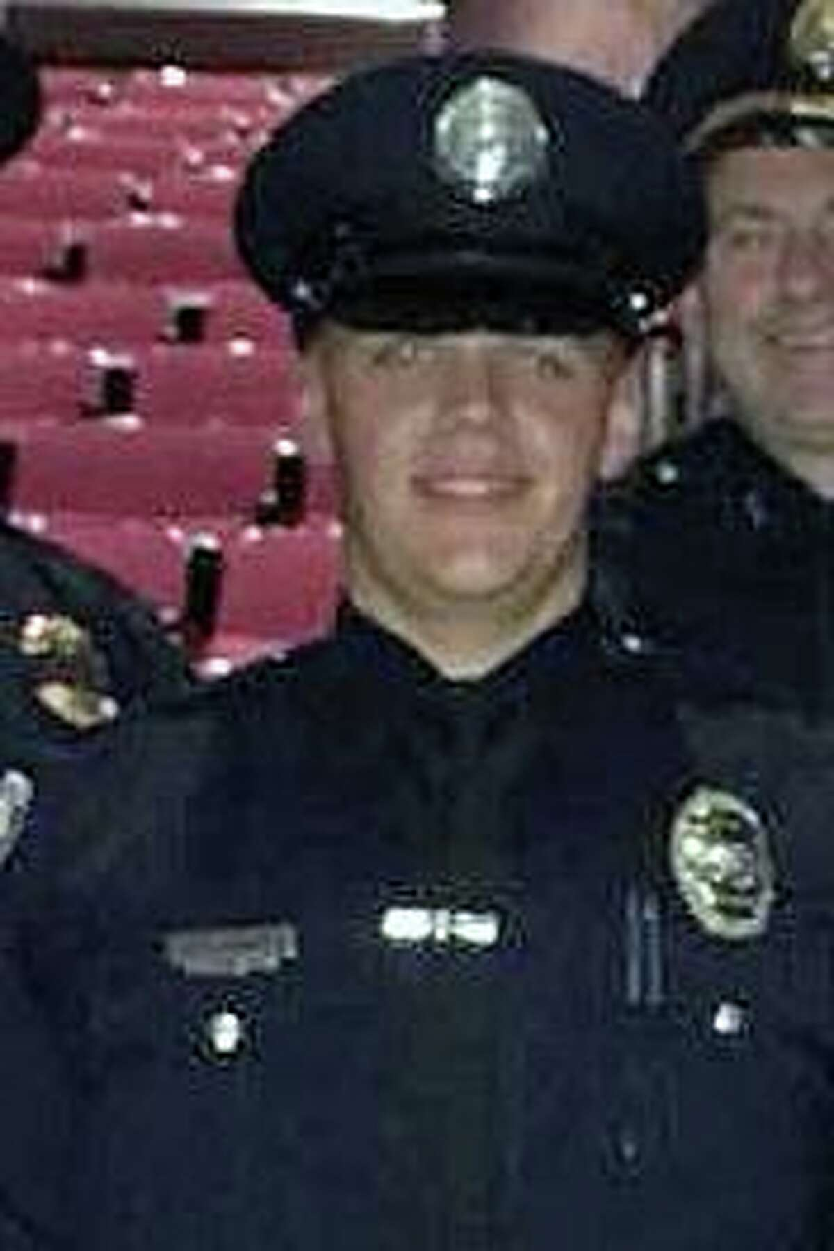 Officer Ben Lovett at his graduation from the police academy on Sept. 20, 2018. Lovett died Tuesday, July 13, 2021, from injuries he suffered in a late June crash while off duty in Tolland, Conn.