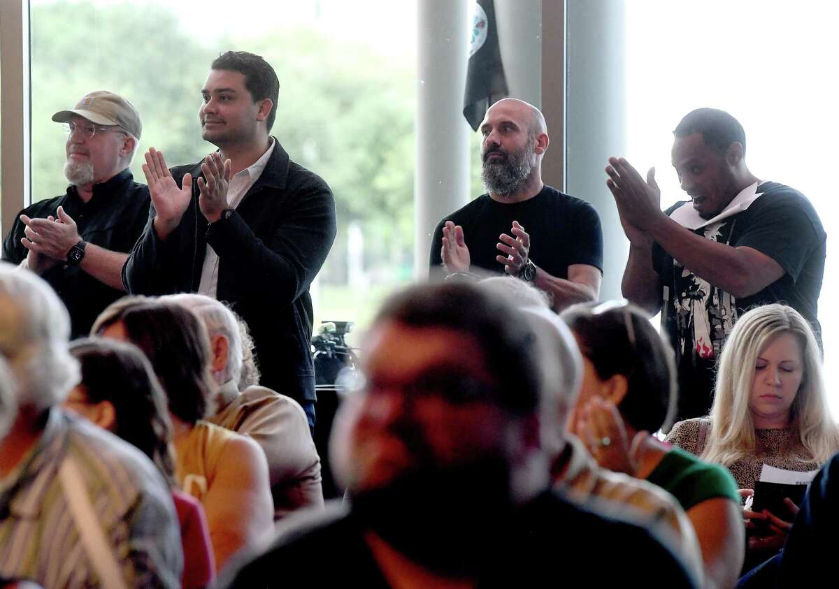 Residents applaud another's comments during the town hall meeting held by Beaumont city council Tuesday at The Event Centre to discuss the purchase of the AT&T Building and proposed riverfront development. Photo made Tuesday, July 13, 2021 Kim Brent/The Enterprise