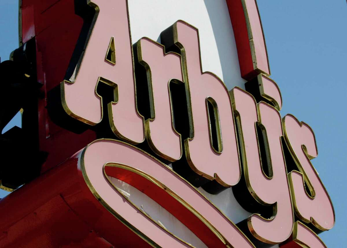 FILE - This March 1, 2010, file photo shows an Arby's restaurant sign in Cutler Bay, Fla. Arby's is buying casual dining chain Buffalo Wild Wings in a deal worth about $2.4 billion. Arby's Restaurant Group Inc. said Tuesday, Nov. 28, 2017, that it will pay $157 per share. (AP Photo/Wilfredo Lee, File)