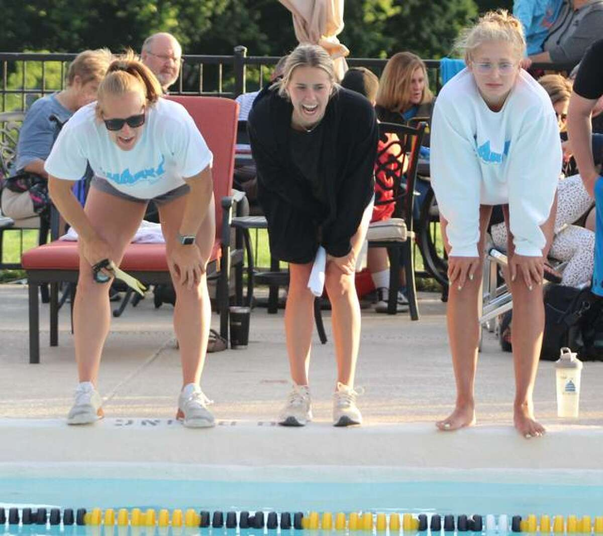 Summers Port head coach Maddie Monroe, left, and assistant coaches Ginny Schranck, center, and Anna Moehn cheer on a Sharks swimmer at the SWISA Relays meet. The Sharks fell to Paddlers of Granite City Tuesday in their last dual meet of the season and will play host to the SWISA Swim Championships Sunday in Godfrey.