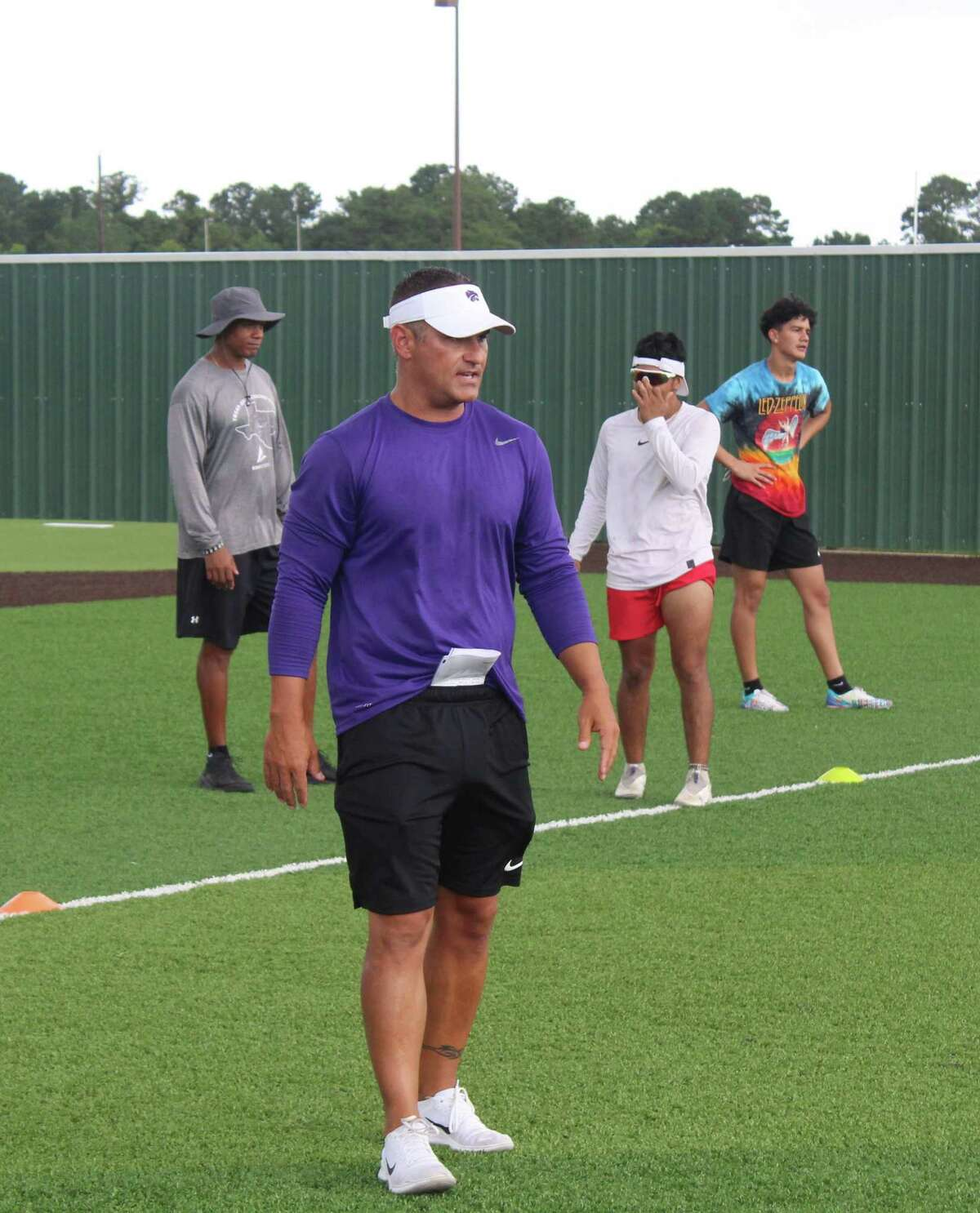 Humble coach Marcus Schulz observing his Wildcats at summer workouts.