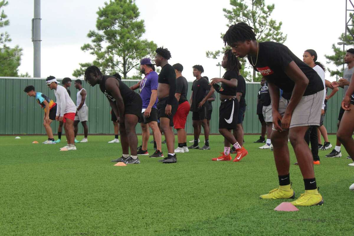 Humble seniors Trevon McCray (right) and X'Zavier Sydney (left) doing running drills at summer workouts.