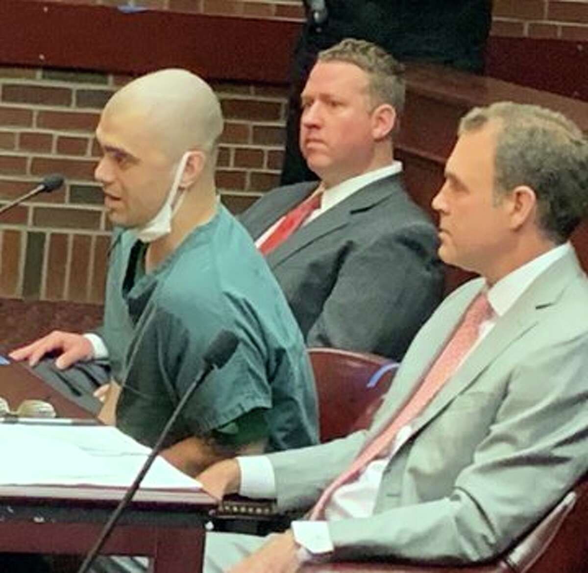 Jimmy Duffy, center, speaks in a Saratoga County court room Wednesday as Judge James A. Murphy III sentenced him to 18 years to life in prison Wednesday for his role in the savage 2019 bludgeoning of 22-year-old Allyzibeth Lamont in a Johnstown deli.