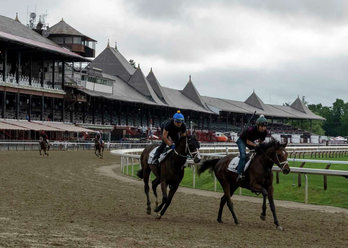 The number of horses is increasing as horses train on the main track at Saratoga Race Course on Wednesday July 14, 2021, the day before the 153rd opening day in Saratoga Springs.