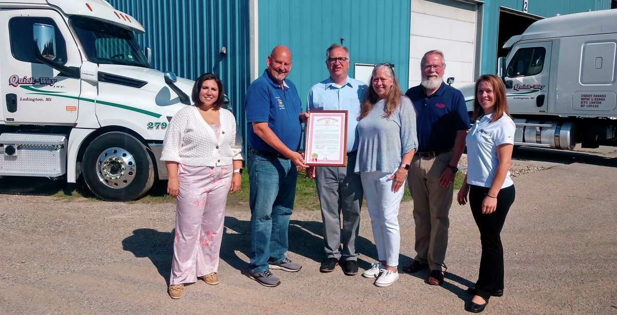 Michigan Sen. CurtVanderWall (second from left) and state Rep. Jack O'Malley (second from right) were on hand at Quick-Way, Inc.'s Ludington terminal to present a plaquefor the business's 30-year anniversary. (Courtesy photo_