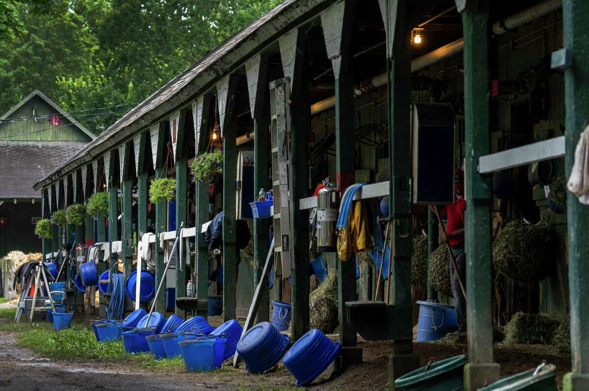 Feed buckets are lined up and ready for their users in the barn area at Saratoga Race Course on Wednesday July 14, 2021, the day before the 153rd opening day in Saratoga Springs.