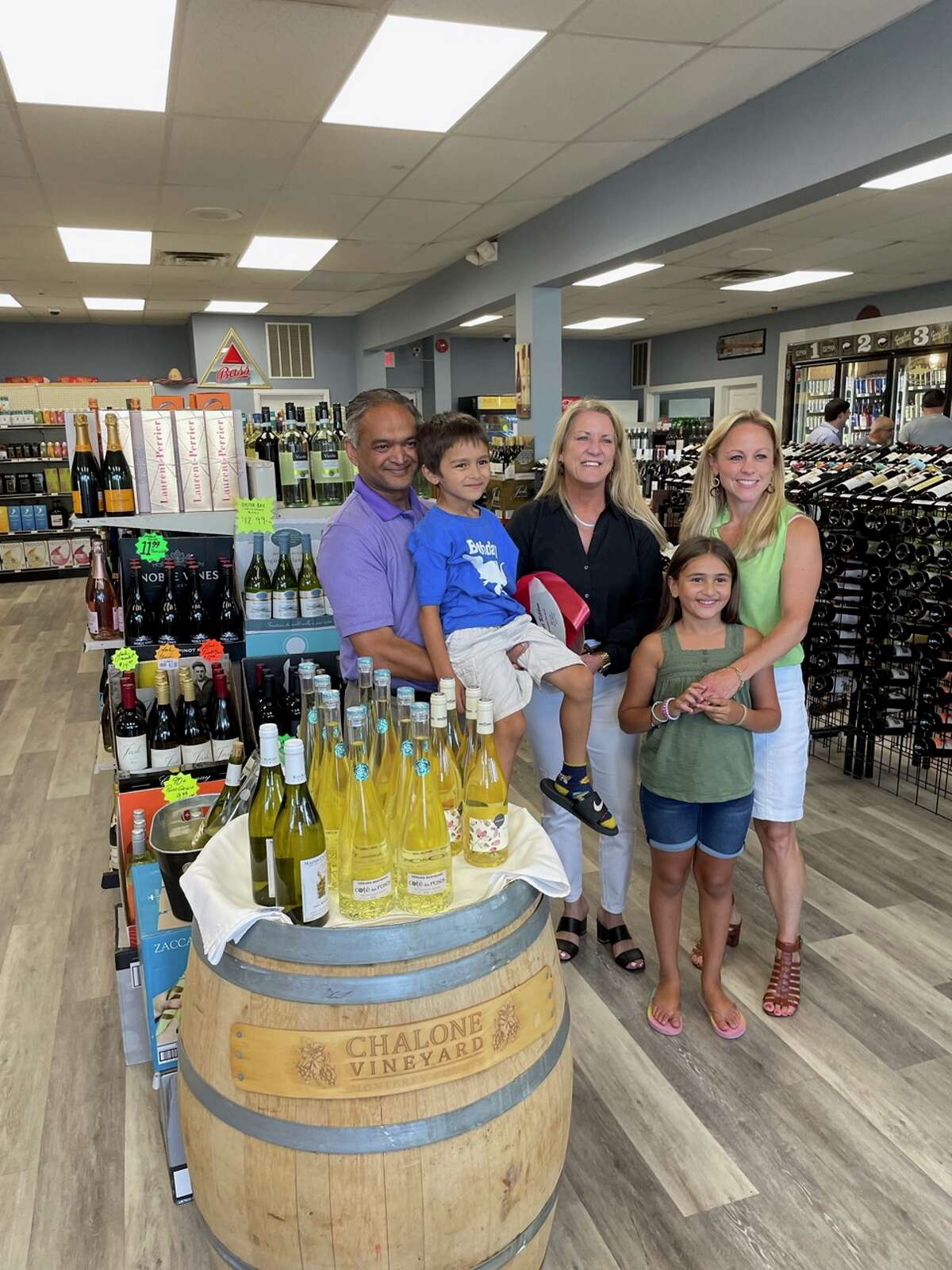 Joel Lall, owner of Higher Spirits in Fairfield, and his family.