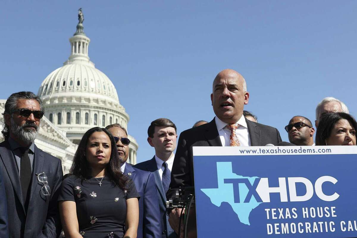 State Representative Chris Turner, a Democrat from Texas, center, speaks at a news conference outside the U.S. Capitol in Washington, D.C., U.S., on Tuesday, July 13, 2021. The Texas Democrats' flight out of state temporarily scuttled Republican efforts to tighten ballot access, increasing national focus on an issue that has swept GOP-led legislatures. Photographer: Oliver Contreras/Bloomberg