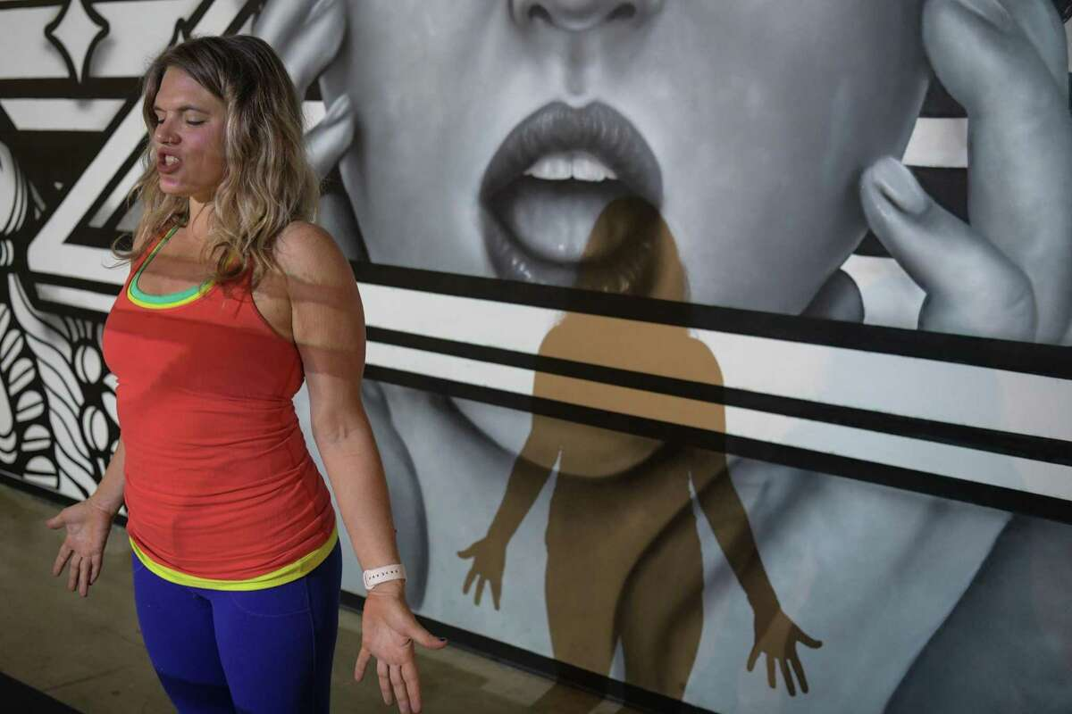 Cassandra Fauss, owner of the Mobile Om traveling yoga studio, leads a class in the mural gallery at Hopscotch.