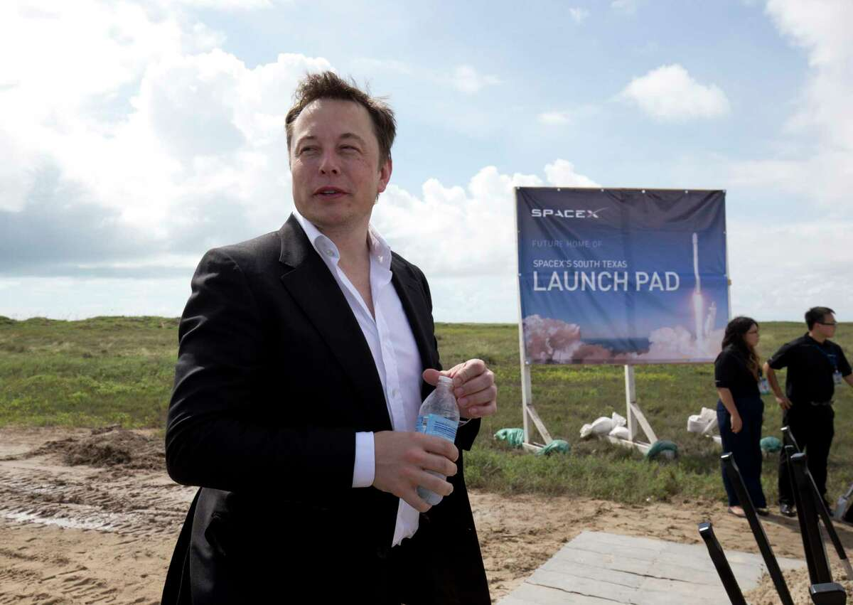 Then-Gov. Rick Perry and SpaceX CEO Elon Musk break ground on the company's spaceport at Boca Chica Beach in South Texas. (Photo by Robert Daemmrich Photography Inc/Corbis via Getty Images)