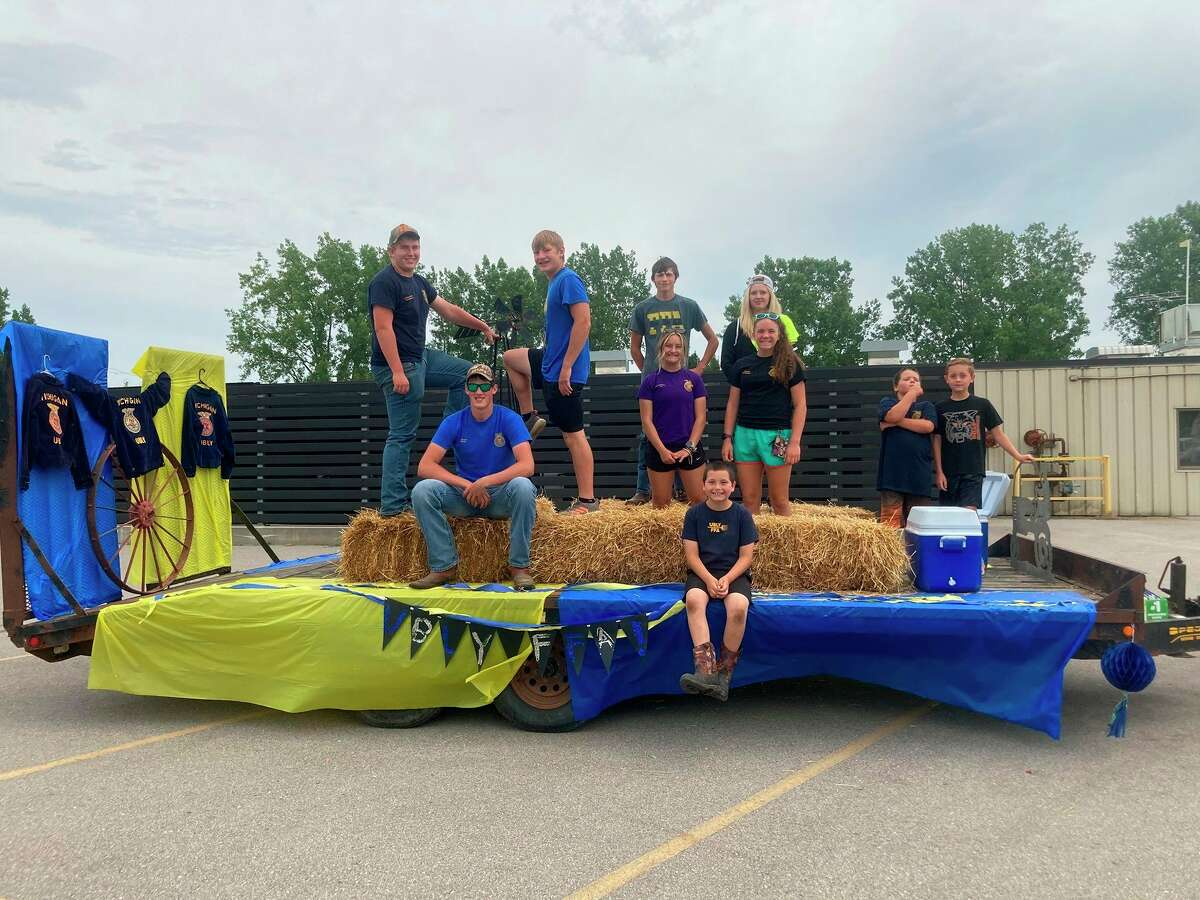 Ubly FFA students pose for a photo on their float for the Ubly homecoming parade July 11. (Courtesy Photo)