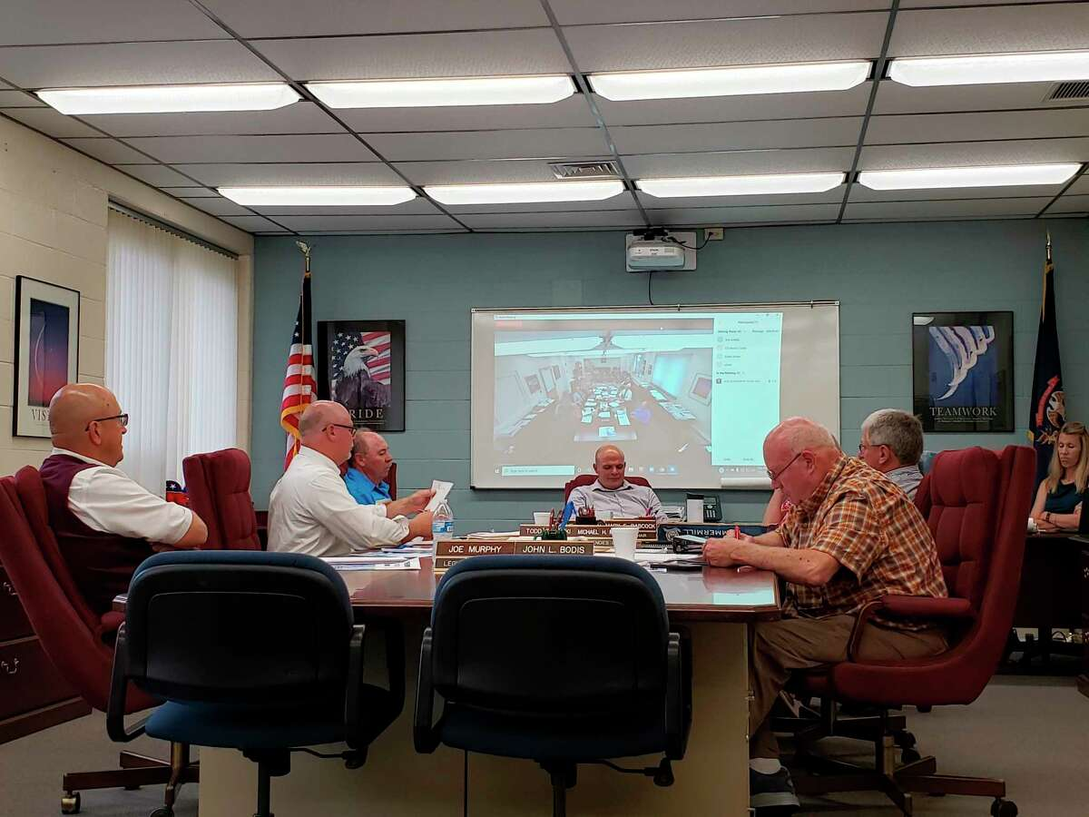 The Huron County Commissioners talk before their meeting this week, where they heard the 2020 audit report for the county government. The commissioners also allocated $2,500 in disaster relief funding for Port Austin Township to help with tornado recovery efforts. (Robert Creenan/Huron Daily Tribune)
