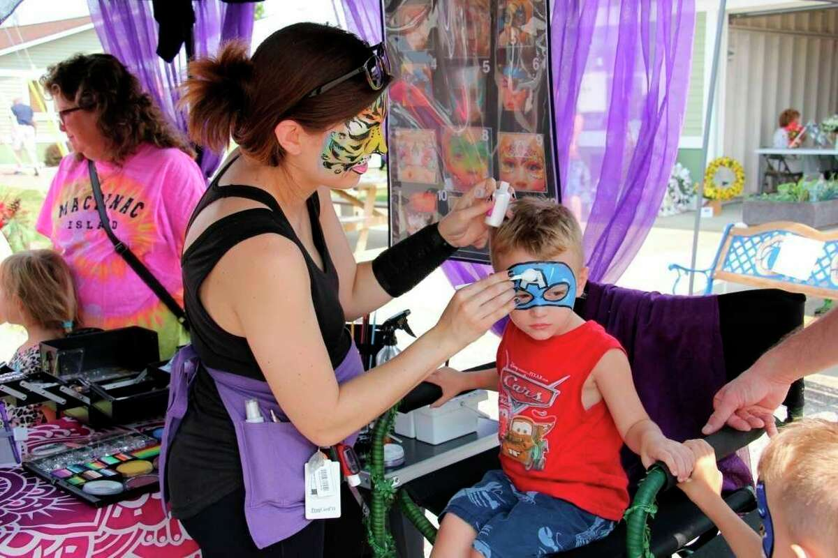 A kid gets his face painted at a past Pigeon Farmer's Summerfest. The annual festival will go on again this year after being canceled in 2020. (Tribune File Photo)