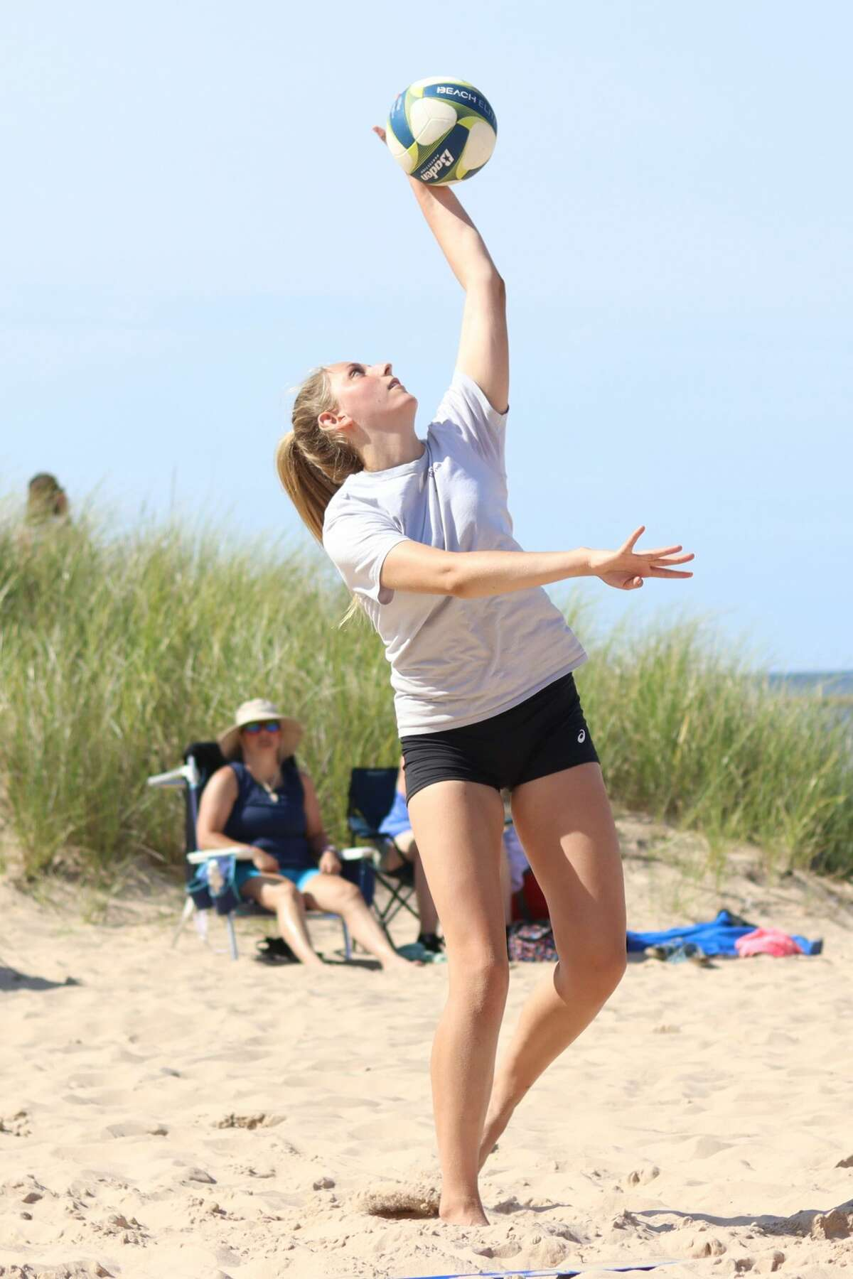 Nearly three dozen teams compete in a youth volleyball tournament at Frankfort Beach on July 11.