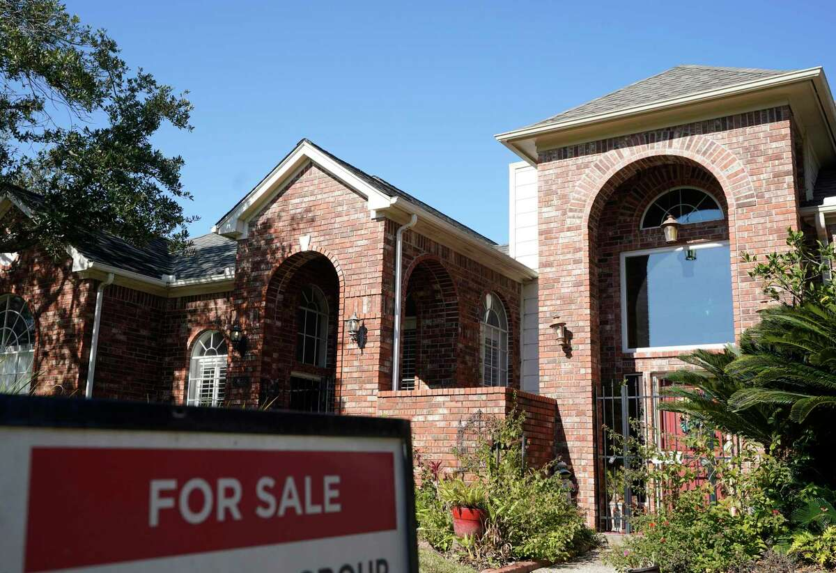 A real estate sign is shown at a home for sale, Wednesday, Jan. 13, 2021, in Houston.