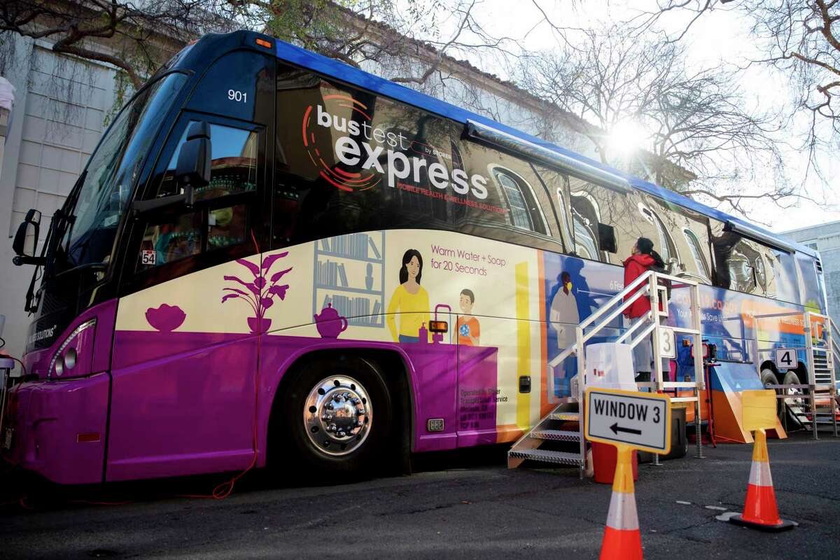 A BusTest Express mobile coronavirus test site is seen parked in downtown Berkeley in January. Though the winter surge has abated, positivity rates are rising again as the highly infectious delta variant spreads through a reopened California.