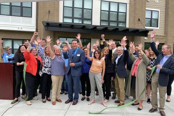 The Saratoga Springs Housing Authority and local elected officials celebrated the completion of Promenade, a 63-unit affordable housing project off Federal Street, on July 13, 2021.