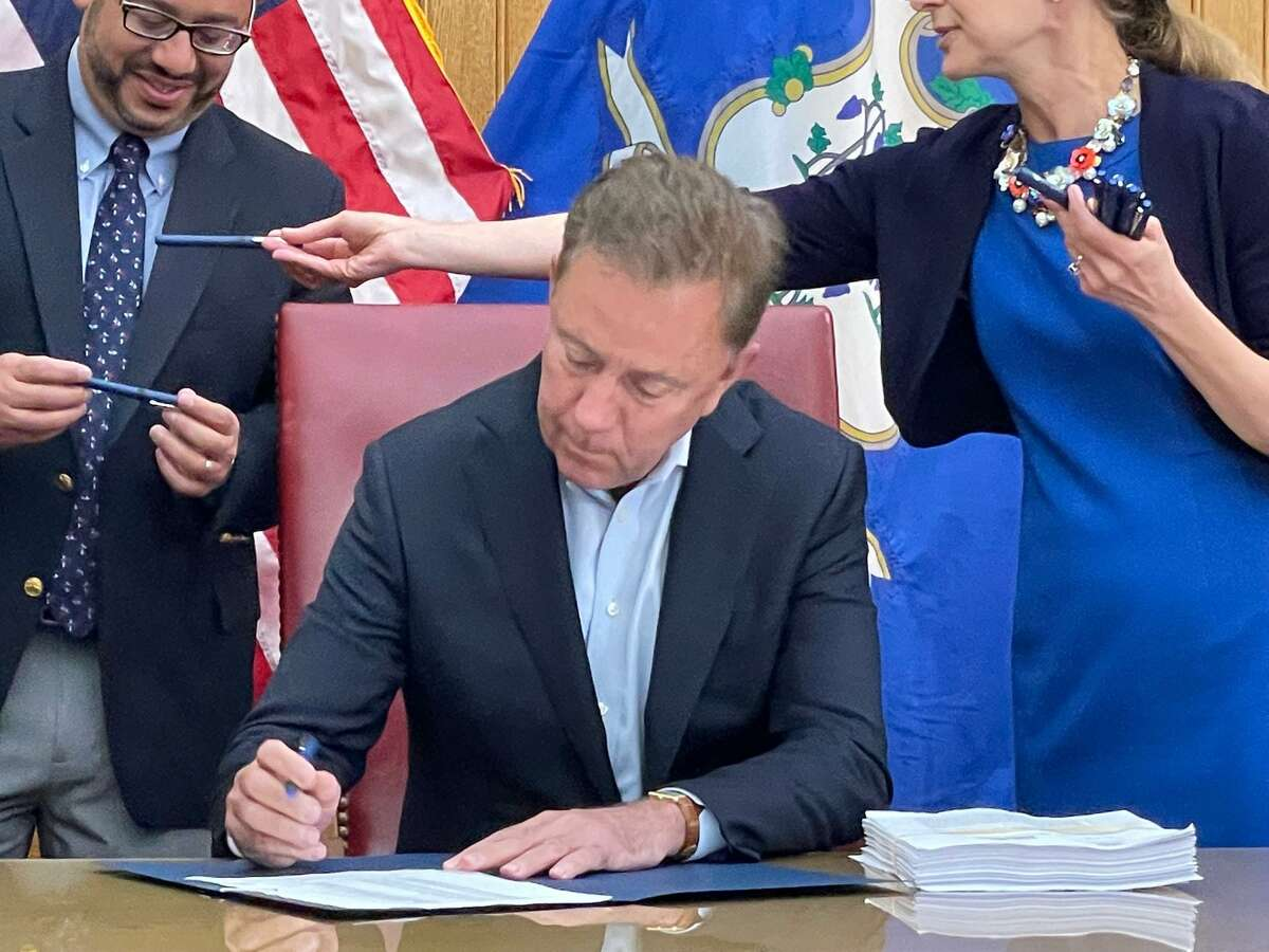 Gov. Ned Lamont signing the cannabis legalization bill into law. It was one of two passed in special session and 239 in regular session.