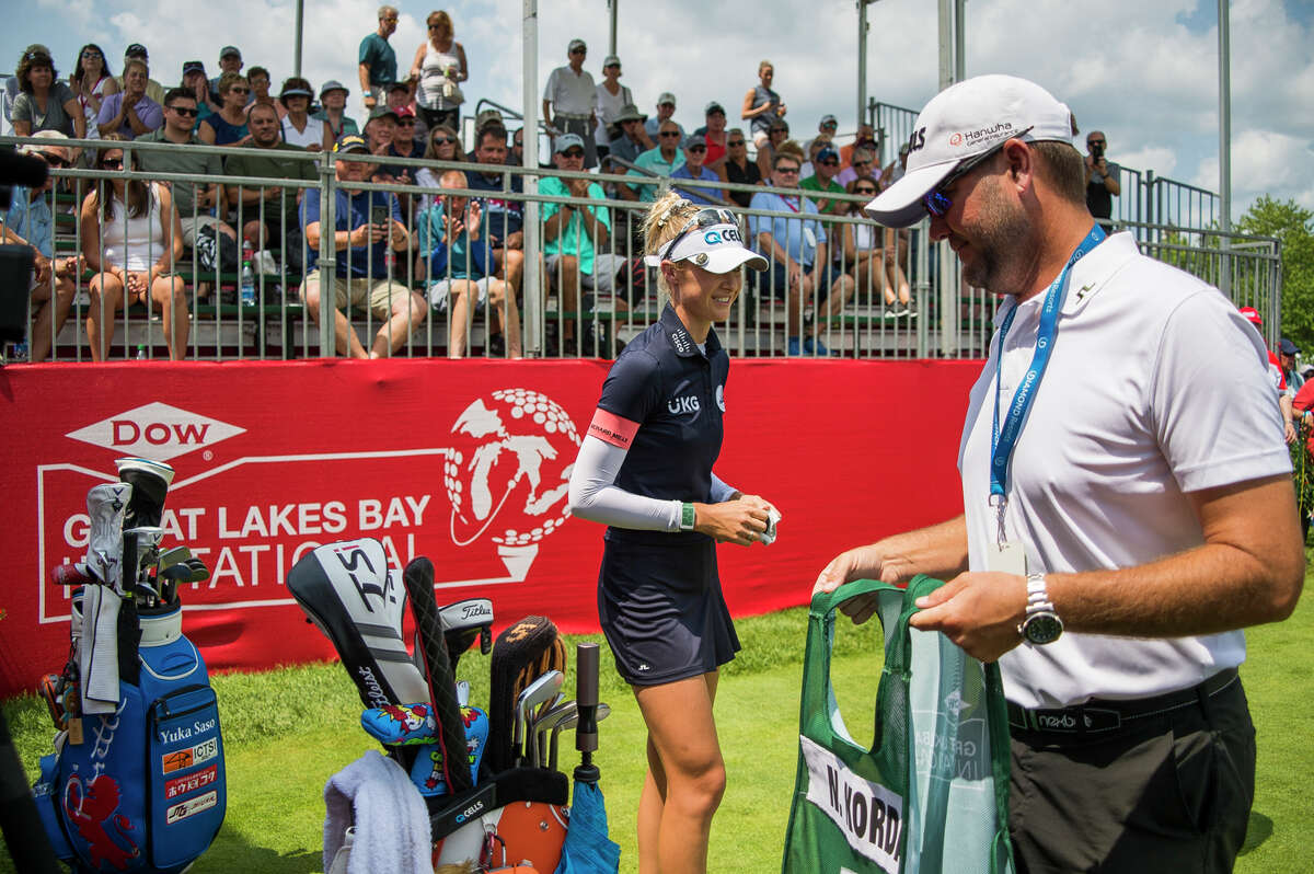 A bib is awarded to LPGA player Nelly Korda's caddie, as a result of Korda reaching the No. 1 spot in the Rolex Women's World Golf Rankings, during the first round of the Dow Great Lakes Bay Invitational Wednesday, July 14, 2021 at the Midland Country Club. (Katy Kildee/kkildee@mdn.net)