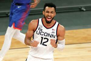 NEW YORK, NEW YORK - MARCH 11: Tyler Polley #12 of the Connecticut Huskies reacts in the first half against the DePaul Blue Demons during the Quarterfinals of the Big East Tournament at Madison Square Garden on March 11, 2021 in New York City. (Photo by Sarah Stier/Getty Images)