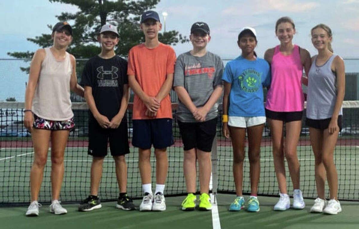 Members of the Edwardsville Junior Tennis 14 Gold team pose inside the YMCA Meyer Center.